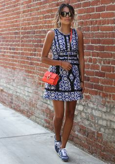 Fashion Fix: Sporty Chic! We think she nailed it with this look - printed dress, bold crossbody and comfy sneaks for the win!