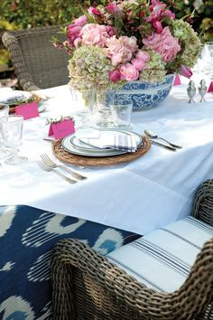 A mixture of patterns, like stripes, ikat, and even chinoiserie porcelain, work together when they're all in the same hue
