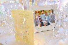 Great idea for table numbers - photos of you and your husband (around Disney World?) holding signs or wooden numbers!