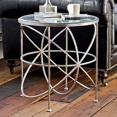Interior HomeScapes offers the Soft Silver Orbit Table by Regina Andrew Design. Visit our online store to order your Regina Andrew Design products today. Glass Side Tables, Metal Side Table, End Tables, Parlour Design, Table Topics, Unique House Design, Happy House, Dining Decor, Elegant Dining