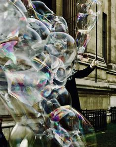 Let The Magic Begin by Barbara Parkins Printed on Giclée Hahnemühle Pearl  London, 2019  I love bubbles. Near the Natural History Museum in London, I stood watching, my camera ready, a children's entertainer created large and beautiful bubbles. He created so many - he disappeared. That's MAGIC!  Colour photograph printed on premium quality photographic paper.  Photographer: Barbara Parkins. Photography Gallery, Street Photography, Art Photography, Female Photographers, History Museum, Stand By Me, Natural History, Bubbles, Pearl