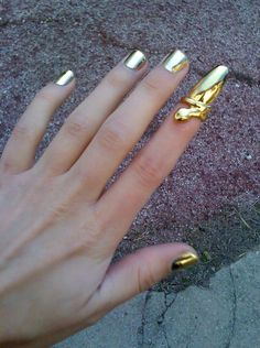 I'm not sure how I feel about the do-hickey on the pointer finger, but I REALLY want the gold nail polish on the others!