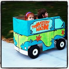 24 Halloween Costumes to Make From a Cardboard Box: Your little red wagon gets a complete Halloween makeover with this Mystery Machine cover!