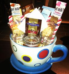 Gift basket idea. Stuffed with chocolate, coffee singles and goodies. The giant cup can also be used as a planter for a house plant.