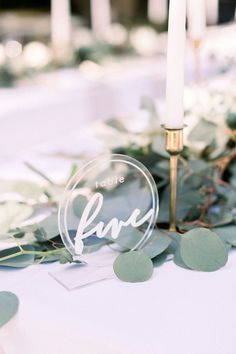 Love these acrylic table numbers from the Green and Grey Garden Wedding featured on The Budget Savvy Bride | Photo by Stephanie Weber Photography #weddings #weddingflowers #centerpiece #weddingcenterpiece #weddingdecor #weddingdecorations #floral