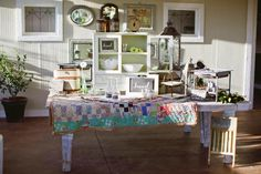 Sarah took inspiration from this dessert table topped with an old quilt, adorned with vintage serving platters and displayed in front of a wall of antique frames. Serving Table, Serving Platters, Country Wedding Decorations, Country Weddings, Rustic Bohemian Wedding, Our Wedding Day, Wedding Ideas, Old Quilts, Antique Frames