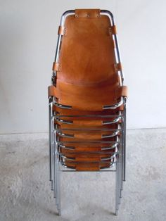 Mid century stacking leather seat chairs by the very talented Charlotte Perriand 1903 - 1999