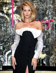 Clothes Lookbook: Rosie Huntington-Whiteley wearing Alessandra Rich Off-the-Shoulder Dress (12 of 13). Rosie Huntington-Whiteley attended the harper by Harper's Bazaar event oozing flirty femininity in a black-and-white Alessandra Rich off-the-shoulder dress, which boasted a thigh-high slit, a huge bow and long sleeves, and the brand's signature streamlined silhouette.