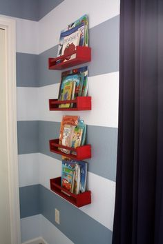 these little red shelves are actually spice racks from ikea, painted  installed in a stacked fashion. These are only $3 each!