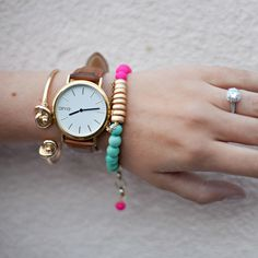 Arm Candy. Arvo watch, knot bracelet, colorful beaded bracelet with tassel.