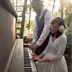 A DIY Countryside Wedding Celebration: playing piano in woods