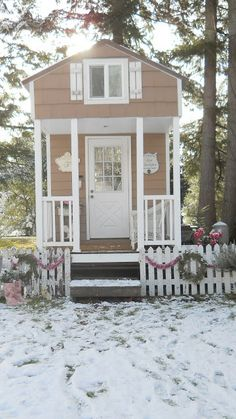 """Here she is, my 8 x 24' tiny house. The interior measures 8 x 18'. My little shabby chic tiny retreat. When I sit in my home it is like being wrapped in a hug. So cozy, so sweet. So perfect. I dressed her in pink and white for the holidays and the theme "" I'm dreaming of a pink Christmas"" seems fitting. """