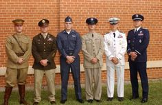 "From left to right, the uniforms are: WWI Army Air Corps, WWII Army ""pinks and greens"" (so called because of the contrast between the jacket and pants), Cold War-era working dark blues, silver tans, Ceremonial Blue, and Ceremonial White. The Ceremonial uniforms, discontinued in the 1990s, were used for dressy occasions where the service uniform was not formal enough and the mess dress uniforms were too formal. Sort of like the Army Blue and White uniforms, or the Navy or Marine dress blues an..."