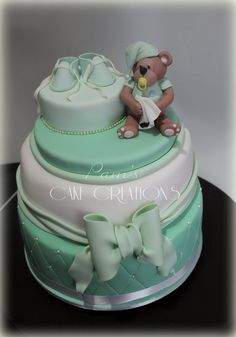 Baby shower cake--not the bear or shoes but love the shape/bow; colors to match sex of baby??