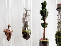 Vertical Dwellings in Glass Test Tubes  Rosa de Jong is an artist based in Amsterdam. Her last series is called Micro Matter. She choses to create small vertical dwellings in glass test tubes. Small sculptures are handmade with natural elements. Creations that play with gravity.        #xemtvhay