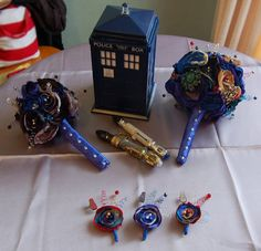 Wedding - TARDIS blue bouquets for the bridesmaids, and the Sonic Screw Drivers for the groomsmen :)