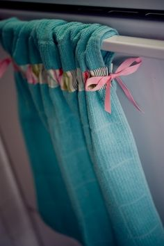 DIY kitchen towel idea. Great way to keep your towel from pulling of the handle every time you use it!