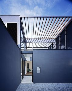 Pergola / APOLLO Architects & Associates great color combination. Gun blue and stainless steel/glass