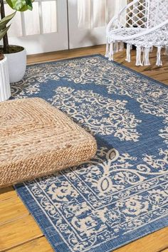 This ornate medallion rug's filigree pattern adds dreamy Bohemian cottage style to your patio, porch or sunroom. Inspired by Mediterranean wrought iron designs, the ivory pattern on a blue background gives this outdoor rug a hand-woven, vintage vibe. The busy pattern is ideal for your entry, kitchen, hallway, living room or bedroom too. JONATHAN Y Indoor Outdoor Area Rugs, Home Rugs, Home Decor Trends, Sunroom, Blue Backgrounds, Cottage Style, Wrought Iron, Filigree, Porch