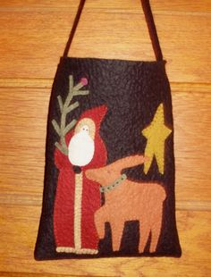 A wonderfully primitive Christmas decoration. Designed by A Piece of Work, this wool felt Christmas Bag will make a beautiful addition to your holiday