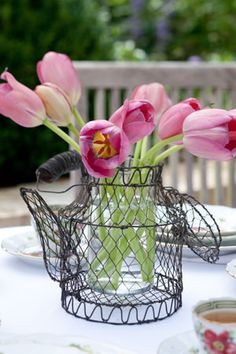 Create a casual arrangement in a basket or watering can. We think this teapot basket is the perfect touch to a garden tea!
