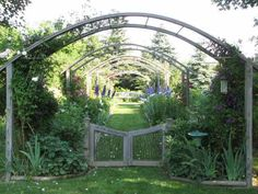 Inspired by Claude Monet's gardens in Giverny, France, these ambitious homeowners designed and built several island gardens and a grand allee with rose arches made from kerfed lumber, copper cable, and tubing. | thisoldhouse.com