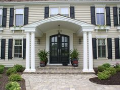 Love me a nice portico with double doors...now to figure this out on my current house...