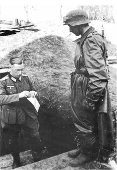 A German motorcycle despatch rider delivers a sealed message to a company officer. German Soldiers Ww2, German Army, Luftwaffe, German Uniforms, Korean War, People Art, Military Art, Vietnam War, Dieselpunk