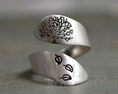 Sterling silver (hallmarked) twisted ring, hand stamped with an autumn tree and falling leaves. The stamping is black enameled (and because of the enameling, it will not wear off).  Please note...
