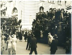 """""""Australia Day 1938"""" - Spectators of the Australian Sesquicentenary parade stand on trams for a better view, George Street, Sydney, 26 January 1938 / photographer Donald Charles Boulton Maclurcan by State Library of New South Wales collection, via Flickr"""