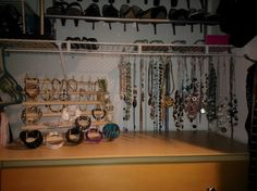 """Jewelry organization - used a thread bob storage rack for bracelets and used 'S"""" ornament hooks to hang necklaces to the underside of wire closet rack."""
