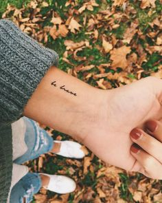 """Be brave"" tattoo on the wrist."