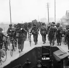 Troops from 3rd Division, some with bicycles, move inland from Queen beach, SWORD Area
