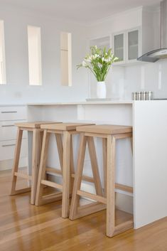 Our handcrafted solid timber Dani Bar Stools fit perfectly in our kitchen. Pictured here in Queensland Blackbutt. Check them out on our website - we make them to order in your choice of timer. Diy Bar Stools, Diy Stool, Wooden Bar Stools, Kitchen Counter Stools, Timber Furniture, Dining Furniture, Custom Furniture, Decor Interior Design, Interior Decorating