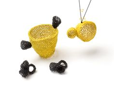 """Pennie Jagiello - """"Sponge cup"""". Rings, pendant, object. Citrine yellow and black electrical wire"""