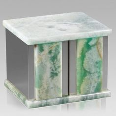 The Ethinity Silver Green Onyx Companion Urn is assembled from real natural quarried stone (Onyx Marble). The urn features a stainless steel trim and has a stainless steel or 24k gold plated decoration option. The bottom has felt to protect the surface were the urn stands. A wonderful natural stone urn for two people. Due to the nature of the stone, colors may vary.