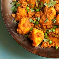 Potato and pea curry - vegan Indian comfort food that's cheap as chips and just as delicious.
