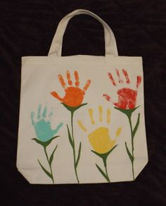 How cute is this? This is a great project for little hands. This tote bag will make a great gift for mom or grandmother. Acrylic matte paints were put onto ticklish hands and pressed onto the canvas tote. We made fun memories making this bag.