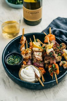 Seafood Skewers with Herbed Oil and Citrus Dipping Cream - La Crema Grab some fresh seafood from your local market and whip up these Seafood Skewers with Herbed Oil and Citrus Dipping Cream. Pair with Monterey Chardonnay. Kabob Recipes, Fish Recipes, Seafood Recipes, Cooking Recipes, Healthy Recipes, Fruit Kebabs, Skewers, Fresh Seafood, Fish And Seafood