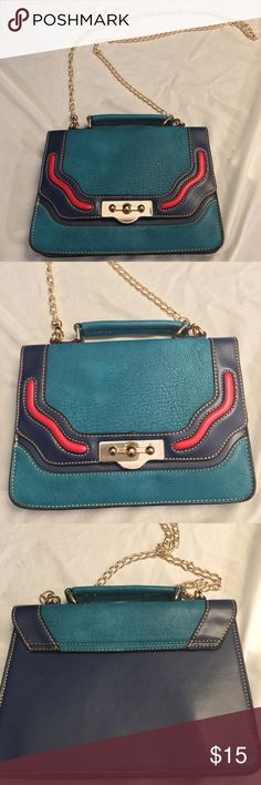 MELIE BIANCO CROSSBODY BAG WITH GOLD CHAIN BLUE MELIE BIANCO BRAND CROSSBODY/SHOULDER BAG WITH GOLD CHAIN. GENTLY WORN GOOD CONDITION NAVY BLUE, TURQUOISE AND RED. THE INSIDE COVER IS BROWN SUEDE AND BLACK NYLON ON INSIDE. PLEASE ASK ANY QUESTIONS! THANK YOU! Bags Crossbody Bags