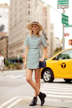 A must-have this season? A straw hat! Whether it's a classic fedora or a chic boater hat, a straw hat is key to this spring outfit formula—just add a striped dress like Jessica's of Tuula. #SpringStyle #Fashion
