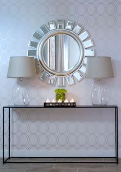 "Stylish console table, clean lines, lamps that are present but not ""there"", back wall, mirror, love!!!!"
