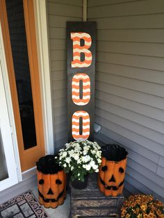 "DIY wooden Halloween ""BOO"" sign. Hobby Lobby wooden letters, Frog Chevron tape, spray paint & acrylic paint. #DIY #woodenboosign #halloweendecor"