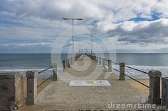 The view from the pier on the beach at the Atlantic Ocean on Porto Santo Island near Madeira Island, Portugal.