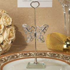 Silver Butterfly Place Card Holder (Cassiani Collection CH020) | Buy at Wedding Favors Unlimited (http://www.weddingfavorsunlimited.com/silver_butterfly_place_card_holder.html).