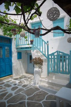 Mykonos spotless whitewashed houses that glimmer in the sun at every turn built like a series of white cubes piled one on top of the other, with their wind Mykonos Grecia, Mykonos Town, Santorini, Exterior Doors, Interior And Exterior, Greece House, Greek Garden, Greek Decor, Myconos
