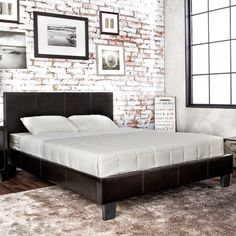 Justify your bedroom decor with this modern platform bed design that offers great color options to match with any bedroom color scheme. The sleek leatherette upholstery wraps tightly around the simple frame while supported upon block feet.