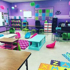 How awesome is 's classroom. I love all of the flexible seating options for the students. The purple color is my favorite too. Classroom Layout, Special Education Classroom, Classroom Design, Future Classroom, Classroom Themes, Classroom Organization, Purple Classroom Decor, Classroom Walls, Classroom Management