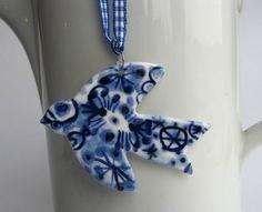 Bird Ornament - Unique Hand painted Porcelain Delftware Christmas decoration. $33.00, via Etsy.