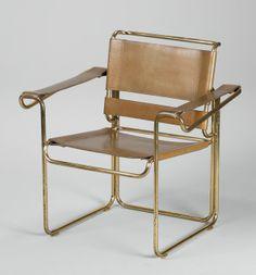 Gastone Rinaldi; Leather and Gilded Tubular Metal Armchair for Rima, 1960s.